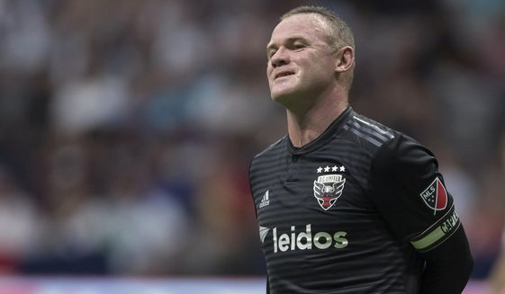 In this Aug. 17, 2019, file photo, D.C. United's Wayne Rooney reacts after putting a shot over top of the Vancouver Whitecaps' goal during the first half of an MLS soccer match in Vancouver, British Columbia. As his Major League Soccer career draws to a close and he prepares to return home, Wayne Rooney would like one more shot at the playoffs stateside. (Darryl Dyck/The Canadian Press via AP) ** FILE **
