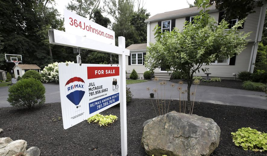 In this July 22, 2019, file photo a sign is displayed outside a house for sale in North Andover, Mass. (AP Photo/Elise Amendola, File)