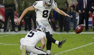 FILE - In this Nov. 18, 2018, file photo, Oakland Raiders kicker Daniel Carlson (8) boots the winning field goal as punter Johnny Townsend (5) holds during the second half of an NFL football game against the Arizona Cardinals in Glendale, Ariz. Carlson could not make a field goal during his short stint in Minnesota and now he cannot miss ever since getting a second chance in Oakland. He returns to Minnesota on Sunday, Sept. 22, 2019, for the first time since the Vikings cut their former fifth-round pick two games into his rookie season as one of the game's most accurate kickers. (AP Photo/Rick Scuteri, File)