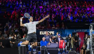 Team Europe's Roger Federer returns a ball during a training session for the Laver Cup in Geneva, Switzerland, Thursday, Sept. 19, 2019. The competition will pit a team of the best six European players against the top six from the rest of the world. The Laver Cup edition is scheduled for Sept. 20-22, 2019 at the Palexpo in Geneva. The Cup is named after the Australian tennis legend Rod Laver. (KEYSTONE/Martial Trezzini)