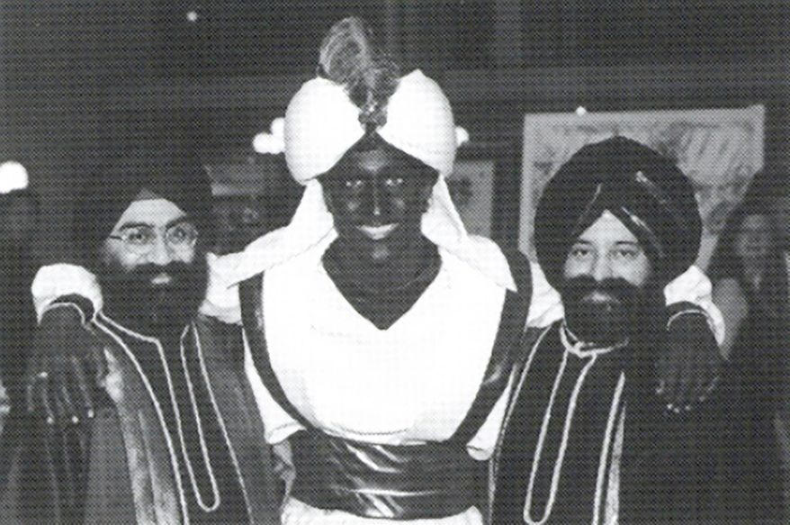 "This April 2001 photo, which appeared in a newsletter from the West Point Grey Academy, shows a costumed Justin Trudeau, his face and hands darkened by makeup, attending an ""Arabian Nights"" gala. The academy is a private school in Vancouver, B.C., where Trudeau worked as a teacher before entering politics. (West Point Grey Academy/The Canadian Press via AP)"