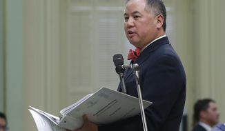 In this Thursday, Sept. 12, 2019 photo, Assemblyman Phil Ting addresses the Assembly in Sacramento, Calif. Ting has a bill that would only allow people to get rebates for electric cars from manufacturers who have agreed to the state's emission standards, which are tougher than those of the federal government. (AP Photo/Rich Pedroncelli)