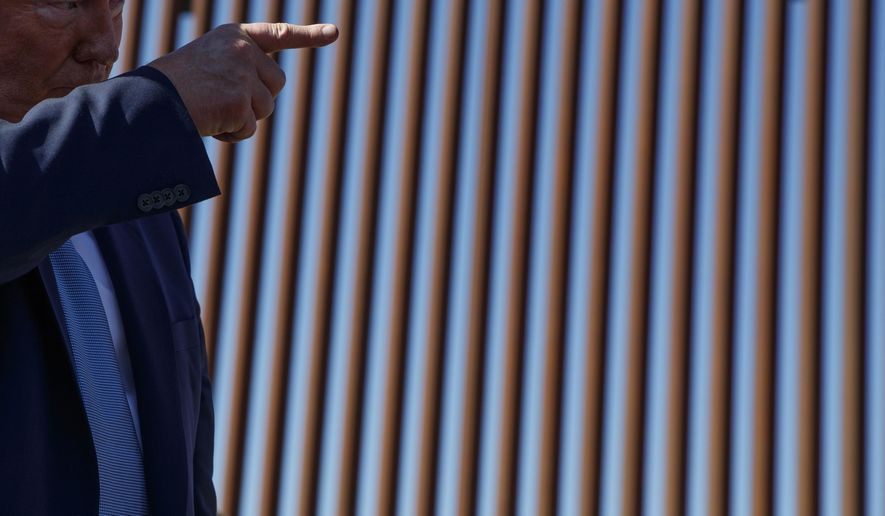 President Donald Trump talks with reporters as he tours a section of the southern border wall, Wednesday, Sept. 18, 2019, in Otay Mesa, Calif. (AP Photo/Evan Vucci)