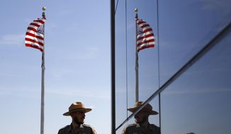 A National Park Service park ranger is reflected in the glass wall of a new security screening building at the foot of the Washington Monument following a ribbon-cutting ceremony to re-open the monument with first lady Melania Trump, Thursday, Sept. 19, 2019, in Washington.  (AP Photo/Patrick Semansky) **FILE**