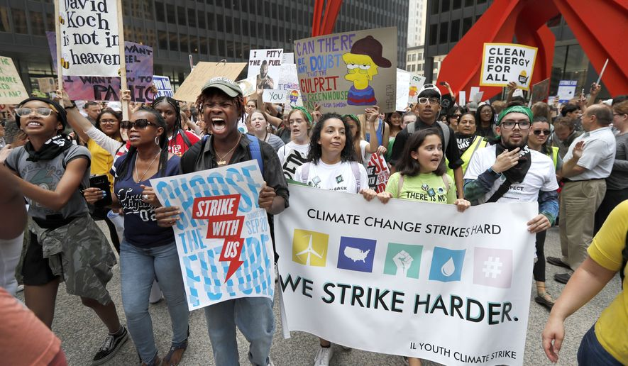Protesters rally on the Federal Plaza inside Chicago's famed Loop during a global climate change march Friday, Sept. 20, 2019, in Chicago. Throughout the world Friday, young people banded together to demand that world leaders headed to a United Nations summit in New York step up their efforts to combat climate change.   (AP Photo/Charles Rex Arbogast) **FILE**