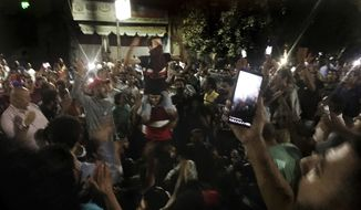 Protesters chant slogans against the regime in Cairo, Egypt, early Saturday, Sept. 21, 2019. Dozens of people held a rare protest in Cairo during which they called on Egyptian President Abdel-Fattah el-Sissi to quit. Security forces dispersed the protesters and no casualties were reported. (AP Photo/Nariman El-Mofty)