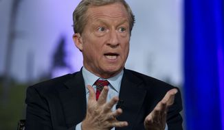 Democratic presidential candidate and businessman Tom Steyer speaks during the Climate Forum at Georgetown University, Friday, Sept. 20, 2019, in Washington. (AP Photo/Jose Luis Magana)