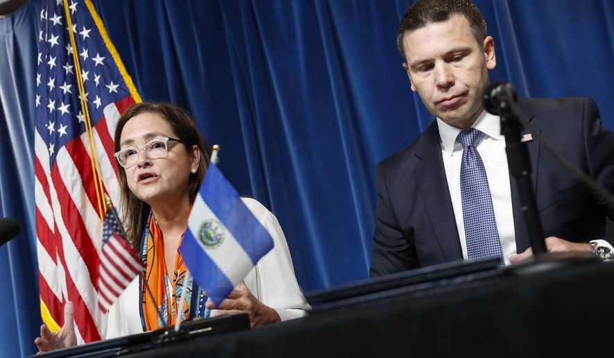 Acting Secretary of Homeland Security Kevin K. McAleenan, right, with Alexandra Hill, left, Minister of Foreign Affairs for El Salvador, during news conference at the US Customs and Border Protection Headquarters in Washington, Friday, Sept. 20, 2019. McAleenan and Hill announced that the US has reached an accord aimed at making El Salvador a haven for migrants seeking asylum. (AP Photo/Pablo Martinez Monsivais)
