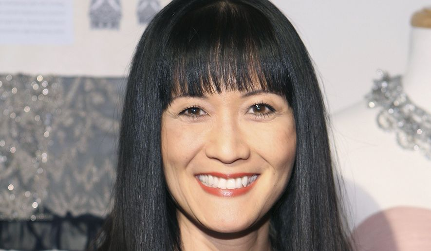 """In this March 6, 2010, file photo, Suzanne Whang attends the Sue Wong Fall 2010 Preview, in Los Angeles. Whang, whose smooth, calm voice provided the narration for HGTV's """"House Hunters"""" for years, died Tuesday, Sept. 17, 2019. She was 57. (Shea Walsh / AP Images for Sue Wong, File)"""