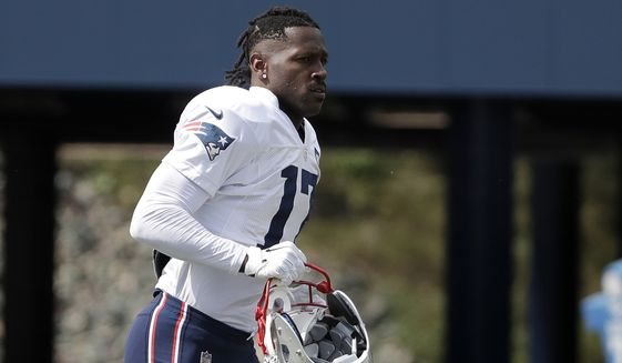 FILE - In this Wednesday, Sept. 18, 2019, file photo, New England Patriots wide receiver Antonio Brown carries his helmet during an NFL football practice in Foxborough, Mass. The Patriots released Brown on Friday, Sept. 20, 2019. (AP Photo/Steven Senne) ** FILE **