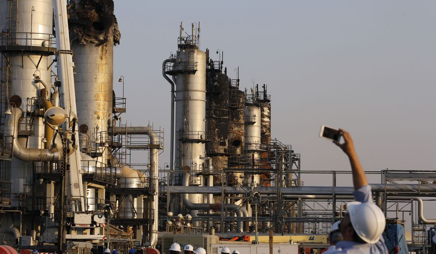 During a trip organized by Saudi information ministry, a cameraman films Aramco's oil processing facility after the recent Sept. 14 attack in Abqaiq, near Dammam in the Kingdom's Eastern Province, Friday, Sept. 20, 2019. Saudi Arabia allowed journalists access Friday to the site of a missile-and-drone attack on a facility at the heart of the kingdom's oil industry, an assault that disrupted global energy supplies and further raised tensions between the U.S. and Iran.(AP Photo/Amr Nabil)