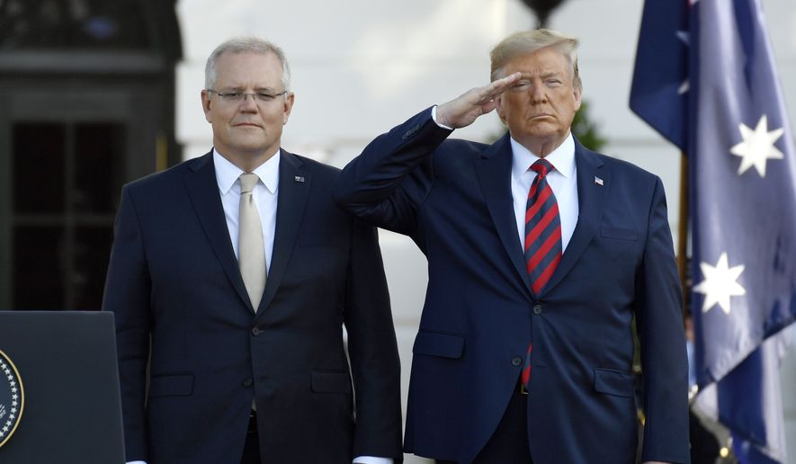 President Donald Trump and Australian Prime Minister Scott Morrison listen to the National Anthem during an State Arrival Ceremony on the South Lawn of the White House in Washington, Friday, Sept. 20, 2019. (AP Photo/Susan Walsh)