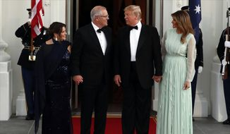 President Donald Trump and first lady Melania Trump stand with Australian Prime Minister Scott Morrison and his wife Jenny Morrison as they arrive for a State Dinner at the White House, Friday, Sept. 20, 2019, in Washington. (AP Photo/Alex Brandon)