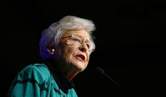 FILE - In this Nov. 6, 2018 file photo Republican Gov. Kay Ivey speaks to supporters after she won the election at a watch party in Montgomery, Ala.  Ivey announced Thursday, Sept. 19, 2019 that she will receive treatment for a malignant spot on her lung. The 74-year-old Republican governor said the spot was discovered in a routine exam and was later confirmed to be what she called a tiny, isolated malignancy. (AP Photo/Butch Dill, file)