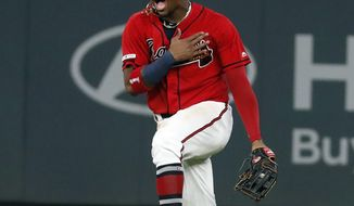 Atlanta Braves center fielder Ronald Acuna Jr. reacts after defeating the San Francisco Giants 6-0 in a baseball game to clinch the NL east baseball title Friday, Sept. 20, 2019, in Atlanta. (AP Photo/John Bazemore)