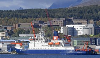 The German icebreaker and research vessel Polarstern at shore in Tromso, Norway, Wednesday Sept. 19, 2019. Scientists from more than a dozen nations are preparing to launch the biggest and most complex research expedition ever attempted in the central Arctic. About 100 researchers will set sail Friday from Tromso, Norway, aboard the German icebreaker Polarstern in an effort to understand how climate change is affecting the Arctic and regions beyond. (Rune Stoltz Bertinussen/NTB Scanpix via AP)