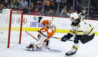 Boston Bruins' Connor Clifton, right, scores a goal past Philadelphia Flyers' Alex Lyon during the third period of a preseason NHL hockey game Thursday, Sept. 19, 2019, in Philadelphia. (AP Photo/Matt Slocum)