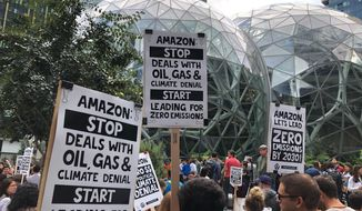 Amazon workers begin to gather in front of the Spheres, participating in the climate strike Friday, Sept. 20, 2019, in Seattle. A wave of climate change protests swept across the globe Friday, with hundreds of thousands of young people sending a message to leaders headed for a U.N. summit: The warming world can't wait for action. (AP Photo/Elaine Thompson)