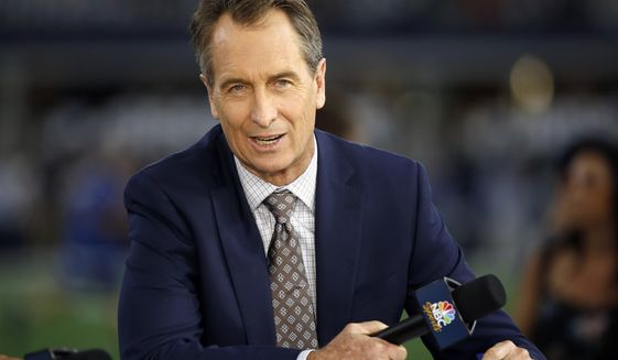 In this Oct. 30, 2016, file photo, NBC Sunday Night Football cast member Cris Collinsworth sits on the set during pregame of an NFL football game between the Philadelphia Eagles and the Dallas Cowboys in Arlington, Texas. TV ratings so far in the 2019 season for NFL football are up on average 5% over 2018, with the biggest ratings jump seen by NBC's Sunday Night Football. (AP Photo/Ron Jenkins, File) **FILE**