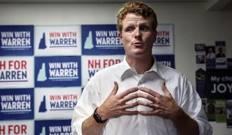 FILE - In this Sept. 5, 2019 file photo, Rep. Joseph Kennedy III, D-Mass., talks to volunteers while campaigning for Democratic presidential candidate Sen. Elizabeth Warren at the New Hampshire for Warren kick off field office opening in Manchester, N.H. Kennedy plans to announce on Saturday, Sept. 21, that he will challenge U.S. Sen. Edward Markey, D-Mass., in the 2020 Democratic primary. (AP Photo/Cheryl Senter, File)