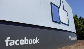 This July 16, 2013, photo, shows a sign at Facebook headquarters in Menlo Park, Calif. (AP Photo/Ben Margot) **FILE**