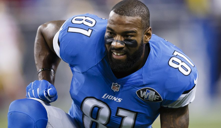 FILE - In this Dec. 27, 2015, file photo, Detroit Lions wide receiver Calvin Johnson (81) warms up before an NFL football game against the San Francisco 49ers at Ford Field in Detroit. The former Lions superstar said the team wanted him to change his story regarding one of the many concussions he had during his nine-year NFL career. (AP Photo/Rick Osentoski, File)