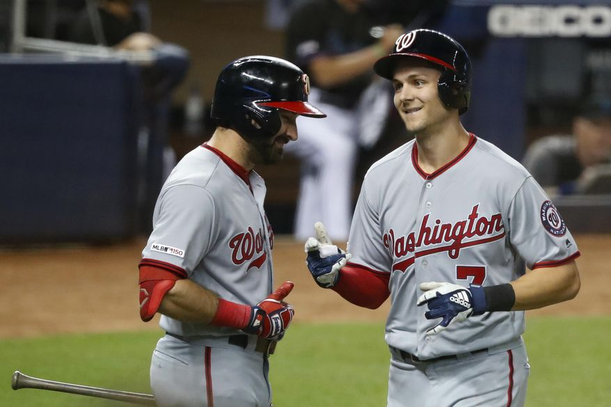 Washington Nationals' Adam Eaton, left, congratulates Trea Turner after Turner hit a home run during the third inning of the team's baseball game against the Miami Marlins, Friday, Sept. 20, 2019, in Miami. (AP Photo/Wilfredo Lee) ** FILE **
