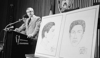 """In this Aug. 9, 1977 file photo, John Keenan, chief of detectives, speaks at a press conference at New York City Police headquarters after two new sketches of the """"Son of Sam"""" were unveiled. Keenan, the police official who led New York City's manhunt for the """"Son of Sam"""" killer, and eventually took a case-solving confession from David Berkowitz, died Thursday, Sept. 19, 2019, at the age of 99.  (AP Photo/Ray Howard, File)"""