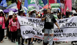 """Environmental activists march a short distance for a rally outside the Department of Environment and Natural Resources to coincide with the global protests on climate change Friday, Sept. 20, 2019 at suburban Quezon city, northeast of Manila, Philippines. Various environmental groups in the country are participating in what is expected to be the world's largest mobilization on climate change known as """"Global Climate Strikes."""" (AP Photo/Bullit Marquez)"""