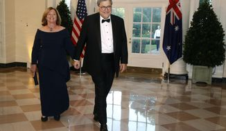 Attorney General William Barr, right, and wife Christine Barr arrive for a State Dinner with Australian Prime Minister Scott Morrison and President Donald Trump at the White House, Friday, Sept. 20, 2019, in Washington. (AP Photo/Patrick Semansky)