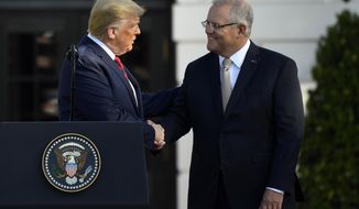 President Donald Trump shakes hands with Australian Prime Minister Scott Morrison during a State Arrival Ceremony on the South Lawn of the White House in Washington, Friday, Sept. 20, 2019. (AP Photo/Susan Walsh)