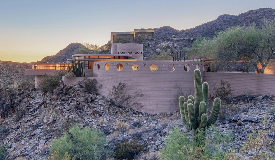 """This undated photo provided by Heritage Auctions in September 2019 shows a home in Phoenix designed by architect Frank Lloyd Wright. The Norman Lykes House will be up for auction in October 2019. Wright designed the home, nicknamed the """"Circular Sun House,"""" before his 1959 death. (Craig Root/Heritage Auctions via AP)"""