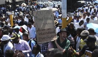 Zimbabewean medical staff march on the streets of Harare, Thursday, Sept. 19, 2019. Zimbabwean doctors protesting the alleged abduction of a union leader won a High court ruling allowing them to march and handover a petition to the parliament.The Zimbabwe Hospital Doctors Association has said its president, Peter Magombeyi, was abducted on Saturday after calling for a pay strike, and members say they will not return to work until he is found. (AP Photo/Tsvangirayi Mukwazhi)