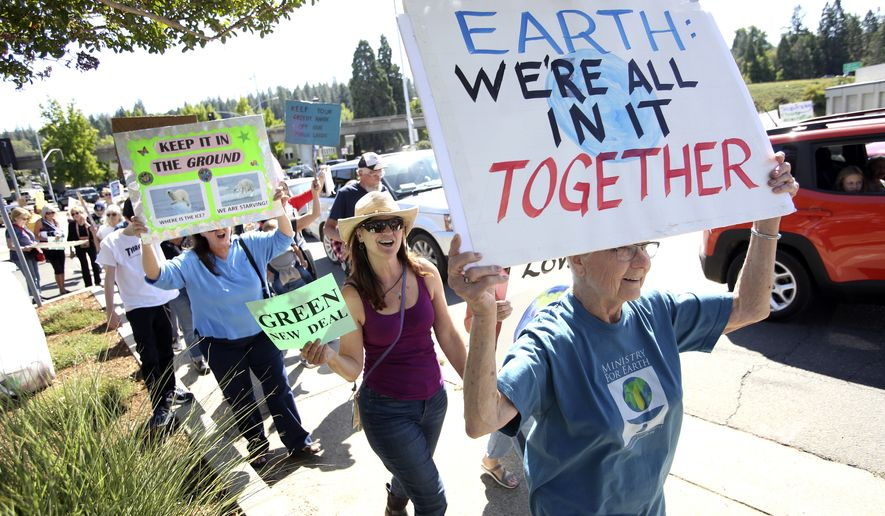 Hundreds of climate activists took to the streets of downtown Grass Valley, Calif., during Friday's global climate strike. People took part in world-wide protests of government inaction on climate change before the the U.N. Climate Action Summit on Monday. (Elias Funez/The Union via AP)