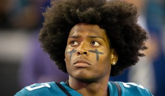 Jacksonville Jaguars cornerback Jalen Ramsey stands on the sideline during the opening ceremonies of an NFL football game between the Jacksonville Jaguars and the Tennessee Titans, Thursday, Sept. 19, 2019, in Jacksonville, Fla. (AP Photo/Stephen B. Morton)