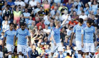 Manchester City's Kevin De Bruyne, center, celebrates after scoring his sides eighth goal during the English Premier League soccer match between Manchester City and Watford at Etihad stadium in Manchester, England, Saturday, Sept. 21, 2019. (AP Photo/Rui Vieira)