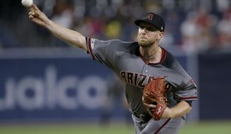 Arizona Diamondbacks starting pitcher Merrill Kelly throws to a San Diego Padres batter during the first inning of a baseball game in San Diego, Friday, Sept. 20, 2019. (AP Photo/Alex Gallardo)