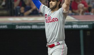 Philadelphia Phillies' Bryce Harper celebrates after hitting a three-run home run off Cleveland Indians relief pitcher Oliver Perez during the fifth inning of a baseball game in Cleveland, Saturday, Sept. 21, 2019. (AP Photo/Phil Long)