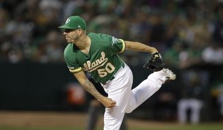 Oakland Athletics pitcher Mike Fiers works against the Texas Rangers in the first inning of a baseball game Friday, Sept. 20, 2019, in Oakland, Calif. (AP Photo/Ben Margot)