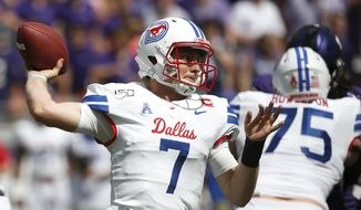 SMU quarterback Shane Buechele (7) throws against TCU during the first half of an NCAA college football game Saturday, Sept. 21, 2019, in Fort Worth, Texas. (AP Photo/Ron Jenkins)