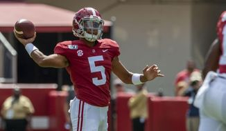 Alabama quarterback Taulia Tagovailoa (5) throws on fourth down to Alabama wide receiver Slade Bolden (18) for the first down against Southern Miss during the second half of an NCAA college football game, Saturday, Sept. 21, 2019, in Tuscaloosa, Ala. (AP Photo/Vasha Hunt)