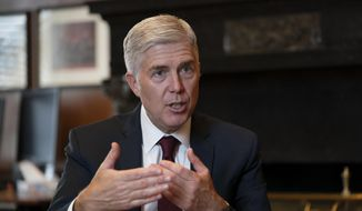 In this Sept. 4, 2019 file photo, Justice Neil Gorsuch, speaks during an interview in his chambers at the Supreme Court in Washington. (AP Photo/J. Scott Applewhite, File)