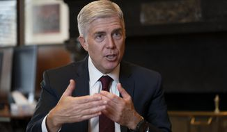 "FILE - In this Sept. 4, 2019 file photo, Justice Neil Gorsuch, speaks during an interview in his chambers at the Supreme Court in Washington. Gorsuch on Friday, Sept. 20, said the conventional wisdom that the court is split along partisan lines based on the political views of the president that appointed each justice is false. Gorsuch spoke about civility at Brigham Young University refuting the notion that judges are just ""like politicians with robes."" (AP Photo/J. Scott Applewhite, File)"