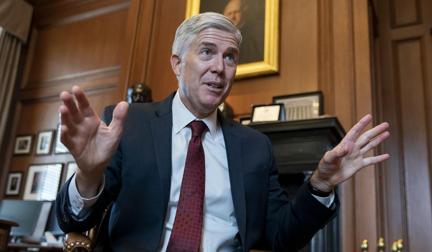 """In this Sept. 4, 2019, file photo, Justice Neil Gorsuch speaks during an interview in his chambers at the Supreme Court in Washington. Gorsuch on Friday, Sept. 20, said the conventional wisdom that the court is split along partisan lines based on the political views of the president that appointed each justice is false. Gorsuch spoke about civility at Brigham Young University refuting the notion that judges are just """"like politicians with robes."""" (AP Photo/J. Scott Applewhite, File)"""