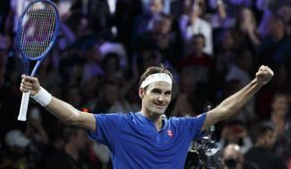 Team Europe's Roger Federer celebrates after winning against Team World's Nick Kyrgios during their match at the Laver Cup tennis event in Geneva, Switzerland, Saturday, Sept. 21, 2019. (Salvatore Di Nolfi/Keystone via AP)