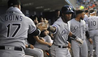 Chicago White Sox' Tim Anderson, right, is congratulated by Ryan Goins after hitting a home run against the Detroit Tigers during the fifth inning of a baseball game Saturday, Sept. 21, 2019, in Detroit. (AP Photo/Jose Juarez)