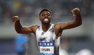 In this May 18, 2019, file photo, Noah Lyles of the United States reacts after winning the men's 100-meter race during the Diamond League Track and Field meet in Shanghai, China. The most promising signal that track and field remains in good hands even after Usain Bolt's retirement comes from a 22-year-old American named Noah Lyles who appreciates the Jamaican superstar more for what he did after his races than during them. When Lyles spends time studying Bolt on video, he looks not at the lanky speedster's form in between the lines, but at the dancing, rollicking post-race celebrations Bolt concocted to make his sport can't-miss viewing whenever he was on the track. (AP Photo) ** FILE **