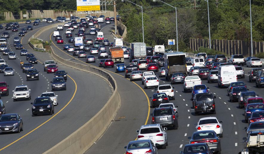 Traffic crawls along the Capital Beltway during rush hour, in Greenbelt, Md., Tuesday, Aug. 25, 2015. (AP Photo/Jose Luis Magana) ** FILE **
