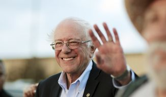 Democratic presidential candidate U.S. Sen. Bernie Sanders waves to supporters after arriving at the Comanche Nation Complex for the annual Comanche Nation Fair Powwow, Sunday, Sept. 22, 2019, in Lawton, Okla. (AP Photo/Gerardo Bello)