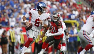New York Giants quarterback Daniel Jones (8) runs against the Tampa Bay Buccaneers during the first half of an NFL football game Sunday, Sept. 22, 2019, in Tampa, Fla. (AP Photo/Mark LoMoglio)